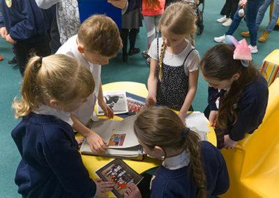 Kingsleigh pupils looking at photos